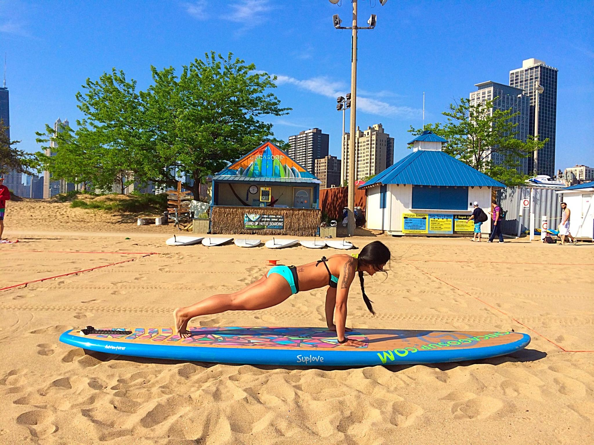 Betina on a stand up paddle board Crosstown Fitness asweatlife fabfitchicago standup paddle board in chicago