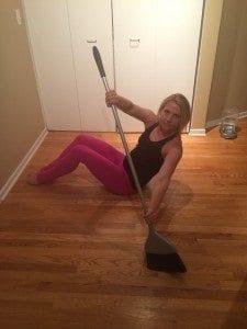 asweatlife fabfitchicago broom lunge no equipment workout broom broom oblique twist bodyweight workout