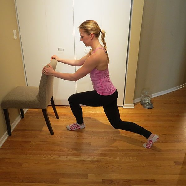 asweatlife_An At-Home Barre Workout_curtsy cross_1