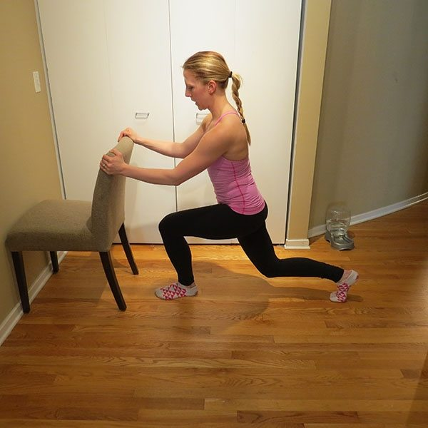 asweatlife_An At-Home Barre Workout_curtsy cross_2