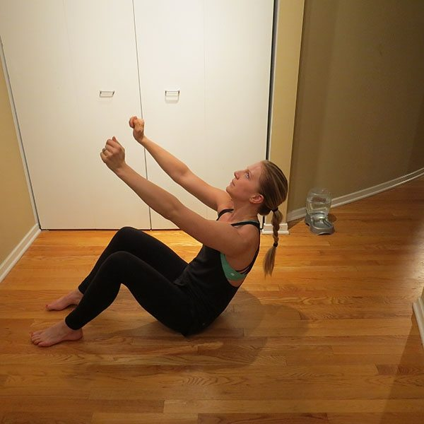 asweatlife_Get Your Heartrate Up with This Bodyweight workout_SIT UP AND TWIST_2