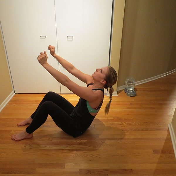 asweatlife_Get Your Heartrate Up with This Bodyweight workout_SIT UP AND TWIST_4