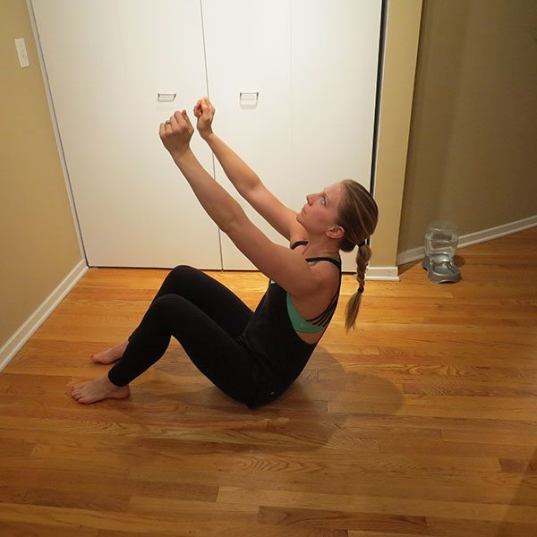 asweatlife_Get Your Heartrate Up with This Bodyweight workout_SIT UP AND TWIST_6