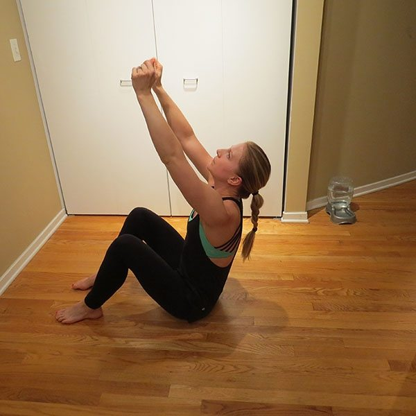 asweatlife_Get Your Heartrate Up with This Bodyweight workout_SIT UP AND TWIST_8