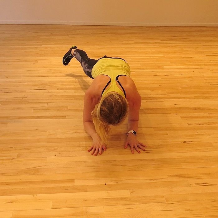 aSweatLife_a total body workout you can do in 30 minutes_Plank with a toe tap out_1