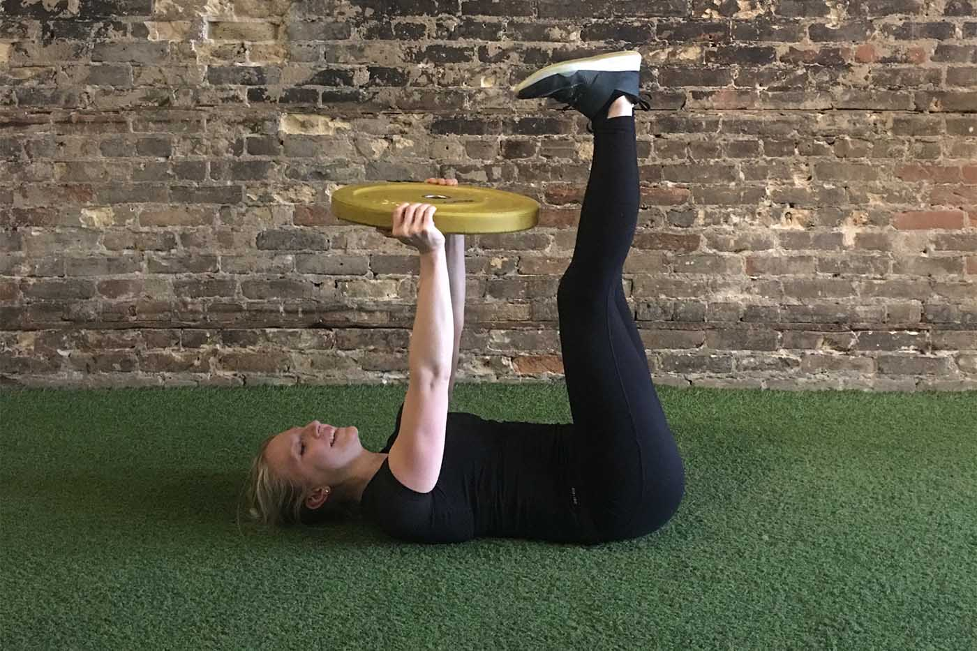 asweatlife_your-30-minute-workout-with-just-a-weight-plate_leg-lift_2