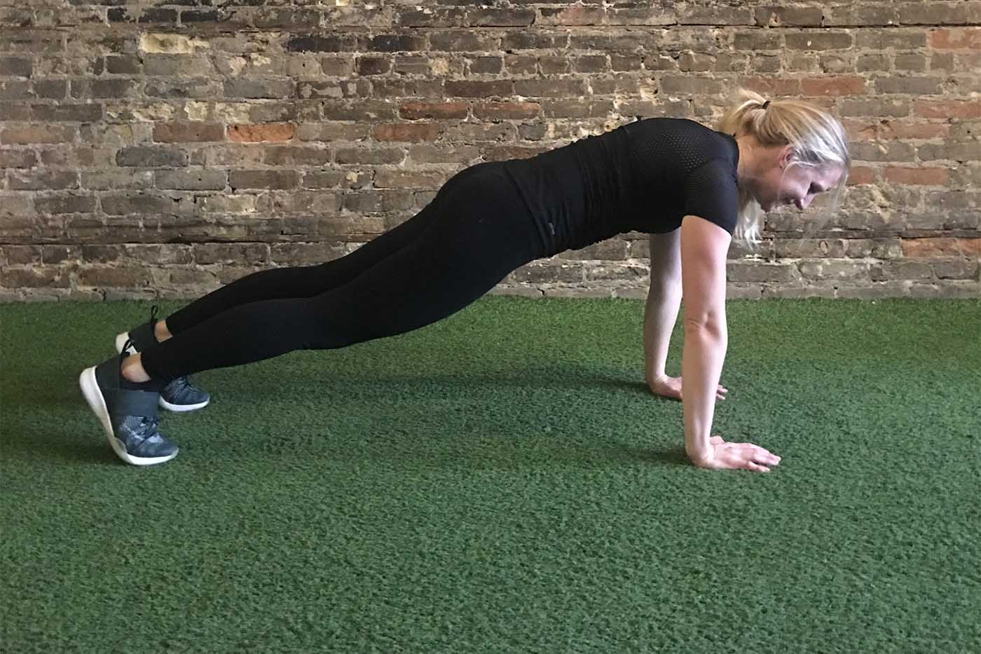 asweatlife_your-30-minute-workout-with-just-a-weight-plate_plank