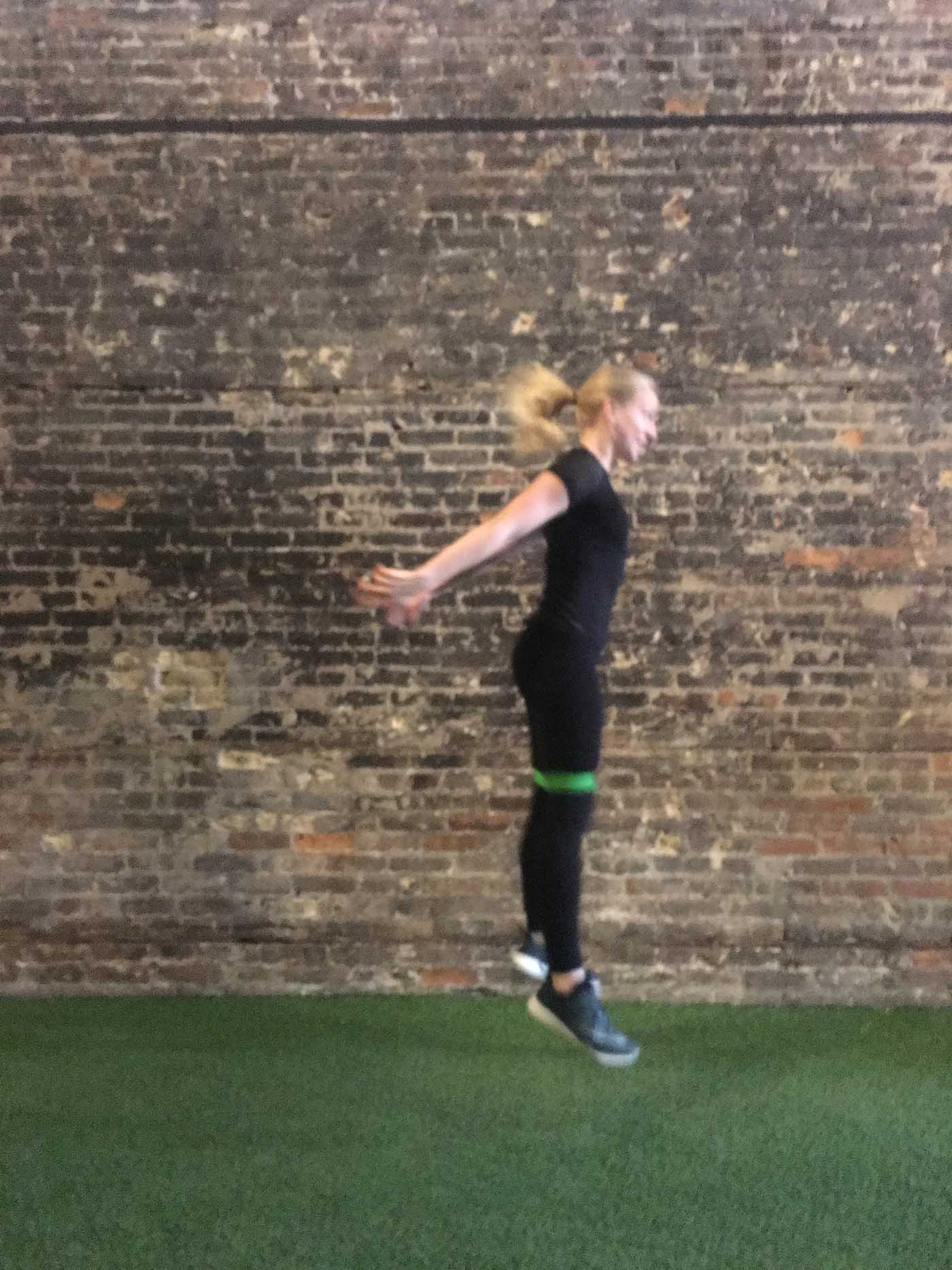 asweatlife_your-30-minute-workout-with-a-band_russian-twists_banded-squat-jump_1