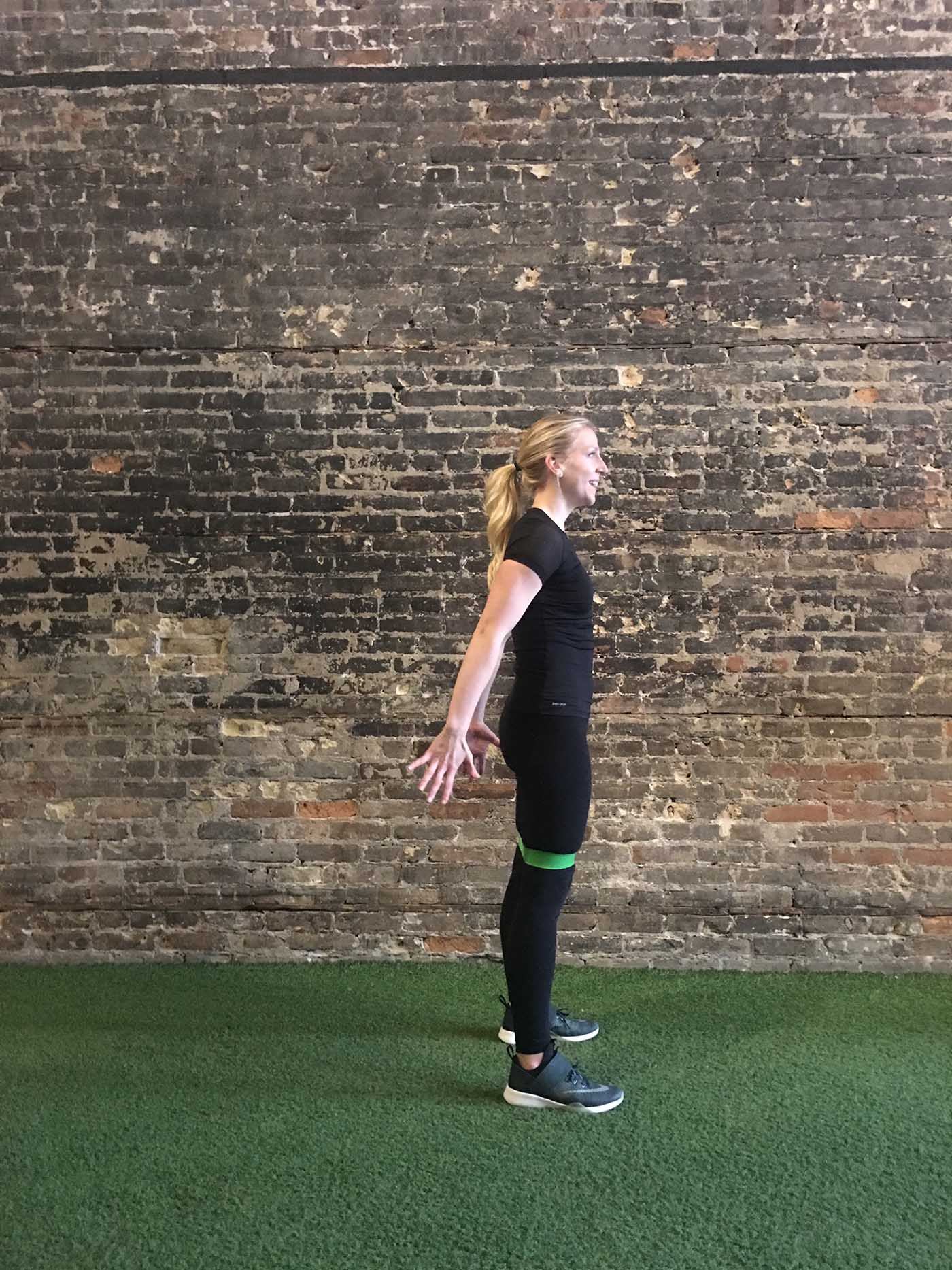 asweatlife_your-30-minute-workout-with-a-band_russian-twists_banded-squat-jump_3