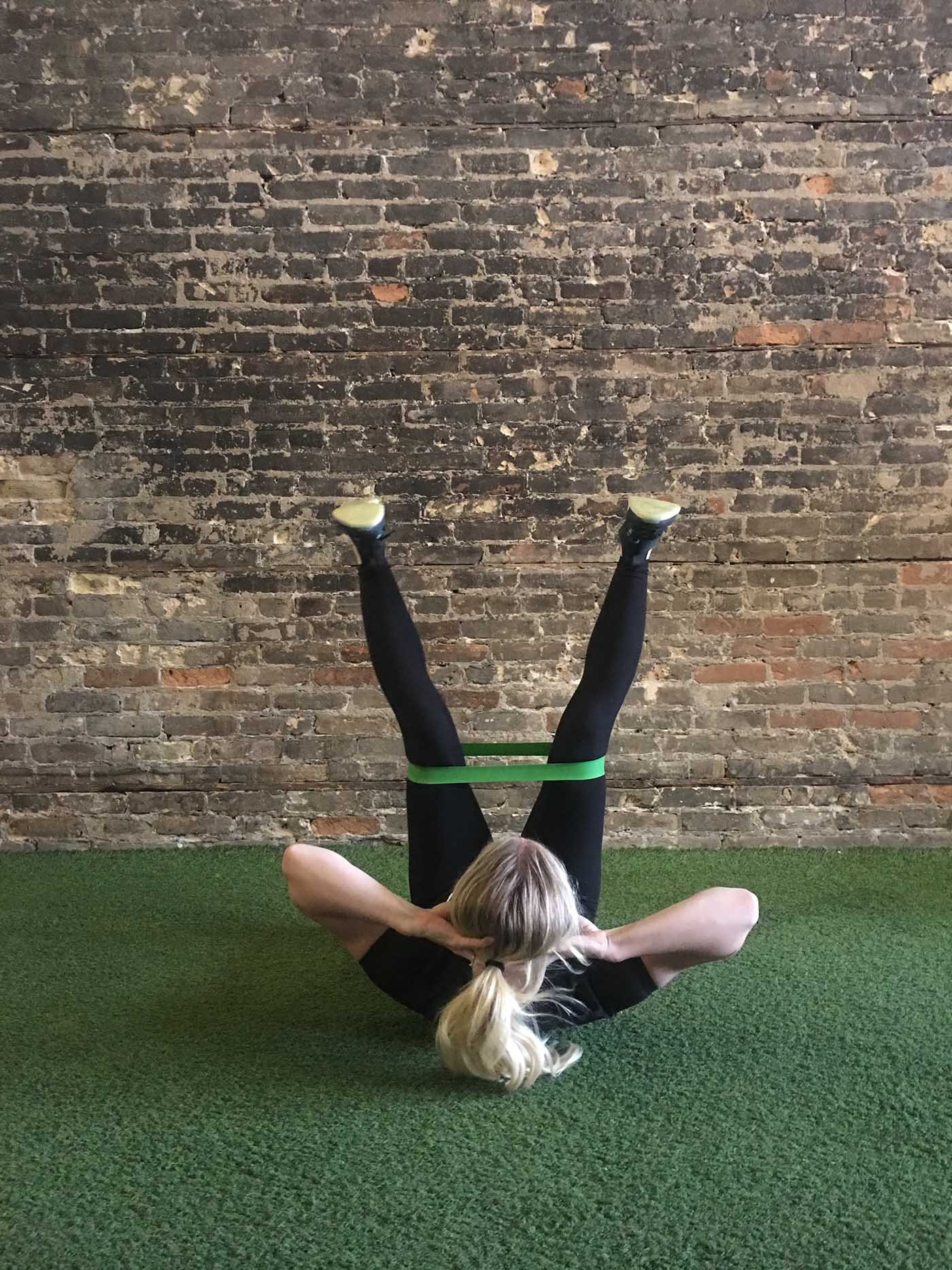 asweatlife_your-30-minute-workout-with-a-band_russian-twists_banded-straight-legged-crunch_2