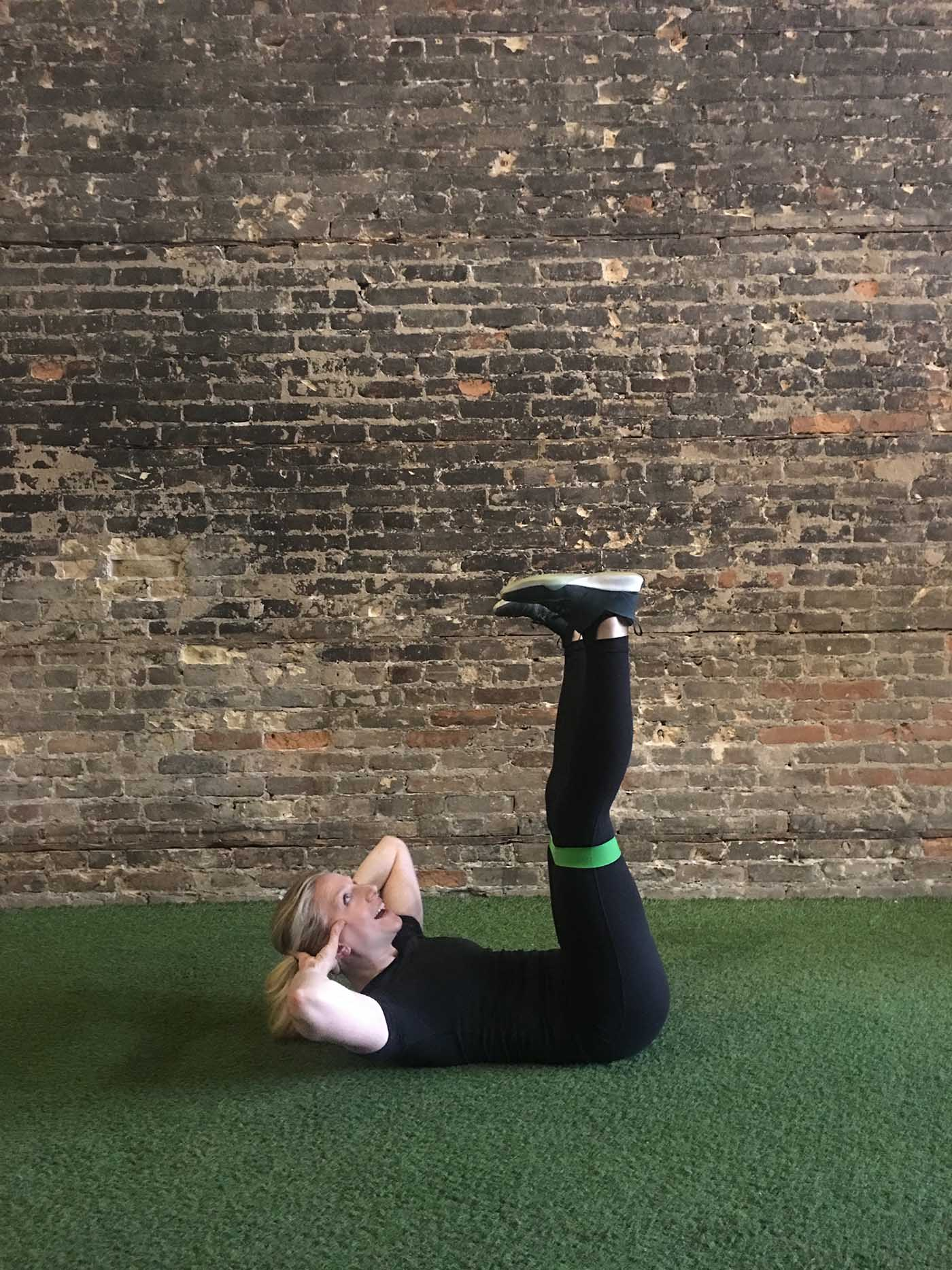 asweatlife_your-30-minute-workout-with-a-band_russian-twists_banded-straight-legged-crunch_3
