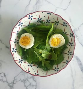 breakfast salad with argula spinach soft boiled egg