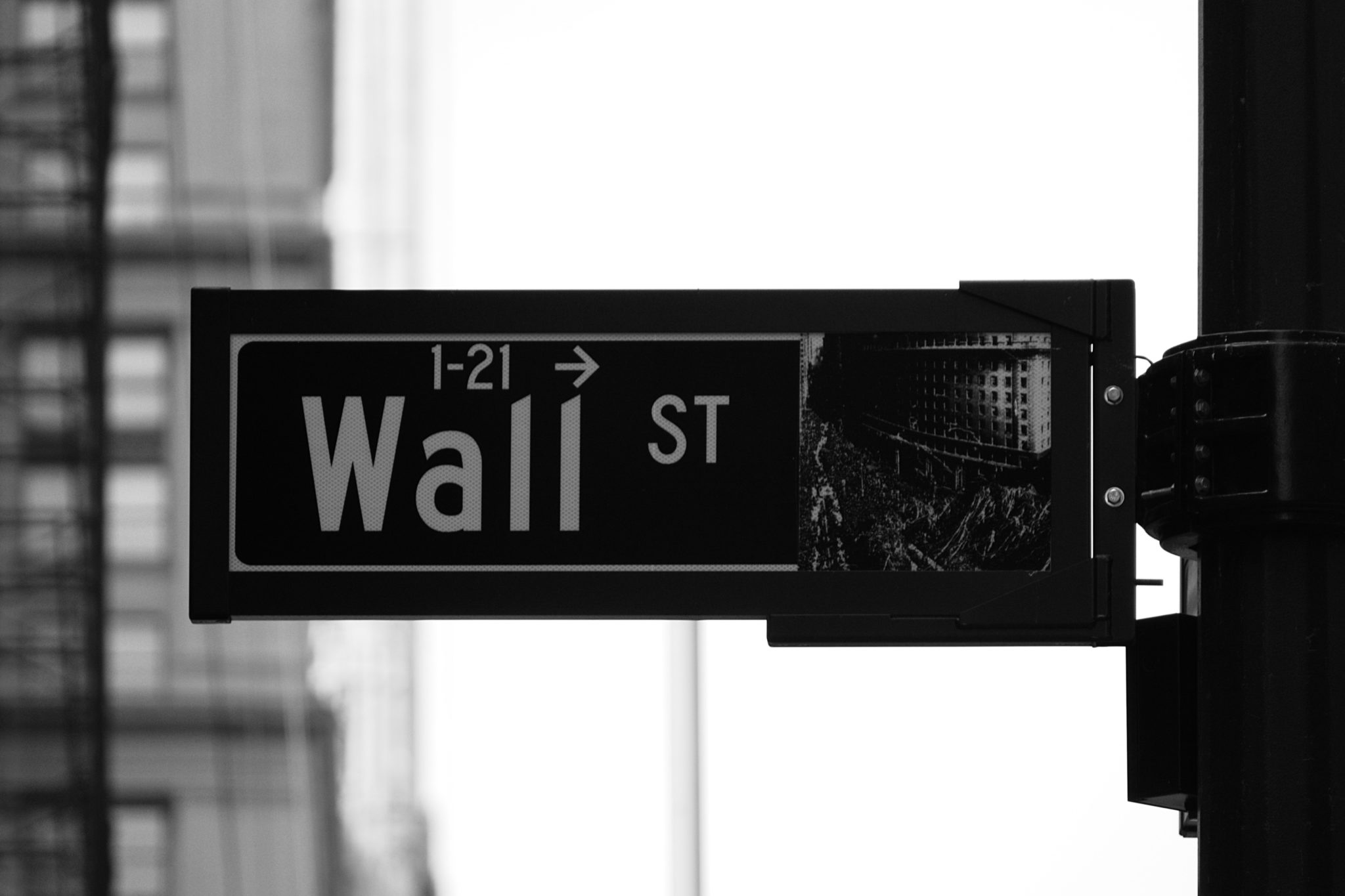 wall street sign how to leave your corporate job to become a trainer