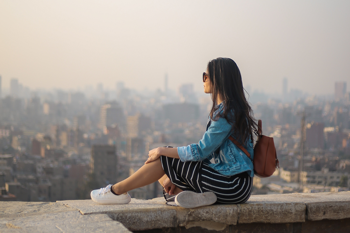 29 things i learned in my 20s woman sitting on a ledge thinking